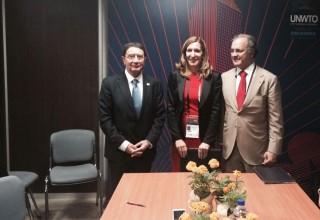 Министрите Ангелкова и Де Лима и генералният секретар на СОТ Талеб Рифай след подписването на споразумението между България и Потругалия